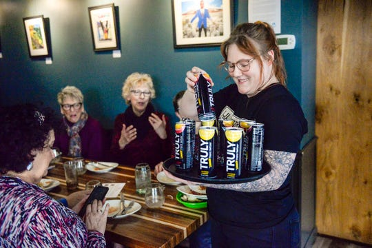 Jules' Bistro staff member Melissa Hessler serves beverages provided by Bernick's Monday, March 9, 2020 at a Lift Up the Ladies event.