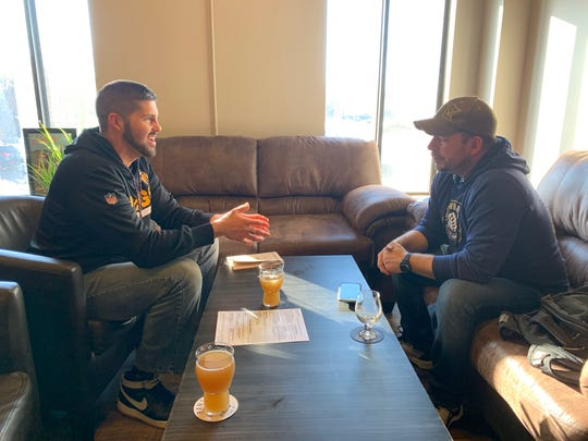 Rep. Dan Wolgamott, D-St. Cloud, speaks with Pantown Brewing Company owner Marty Czech in February 2020.