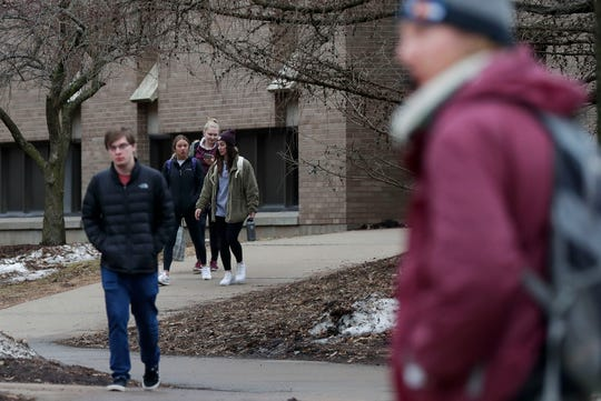University of Wisconsin-Stevens Point students walk between classes on Wednesday on the Stevens Point campus.