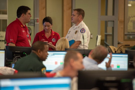 Emergency officials chat during the Leon County Emergency Operations Center  activation during Hurricane Michael. The EOC has been activated as the county prepares for a possible outbreak of coronavirus.