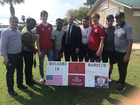 Members from Miami Ajax pose with coach Mohammed Jamai (far right in hat), Moroccan counsul general from New York City Abdelkader Jamoussi (center) and vice counsul general Drisse Kacimi (far left).