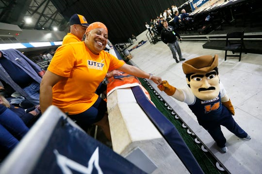UTEP fan Pat Flores and Paydirt Pete before the game against Florida Atlantic Wednesday March, 11, in the first round of Conference USA games in Frisco, Texas.