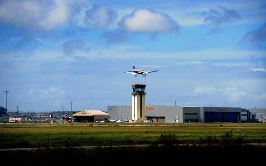 An airplane lands at Camarillo Airport. A proposed $32 million jet hangar project at the airport is raising concerns it might violate a 1976 agreement between the city of Camarillo and Ventura County that limits the weight of jets at the airport to 115,000 pounds.