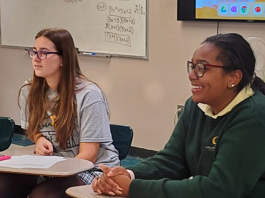 Ani Schubert (left) of Sicklerville and Emma Drayton of Vineland react to a discussion taking place in their Sister Speak session at Our Lady of Mercy Academy in Newfield.