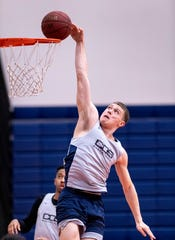 Ryan Johnson practices with the College of the Sequoias mens basketball team on Tuesday, March 10, 2020.