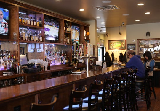 A couple has lunch at North End Tavern, a restaurant in the 1-mile radius Gov. Cuomo's 'containment area' of the coronavirus in New Rochelle March 11, 2020.