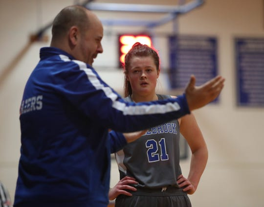 Millbrook head coach Adam Peek talks with Erin Fox (21) on the sideline during the second half of the girls Class C regional semifinal basketball game at Haldane High School in Cold Spring on Wednesday, March 11, 2020.  Milbrook won 60-46.