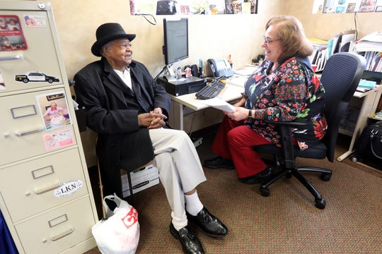 Program Specialist Deborah McLeroy helps Pernie Allmond, 83, of New Rochelle with paperwork for his benefits at the Hugh A. Doyle Senior Center in New Rochelle March 11, 2020. The center is closed until further notice under the orders of the coronavirus containment. However they are open on an appointment basis for seniors that need recertification to continue their benefits.