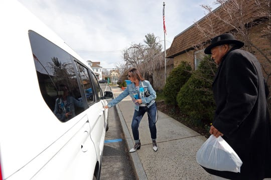 Driver Christine Amori gives Pernie Allmond, 83, of New Rochelle a ride after his visit to the Hugh A. Doyle Senior Center in New Rochelle March 11, 2020. The center is closed until further notice under the orders of the coronavirus containment. However they are open on an appointment basis for seniors that need recertification to continue their benefits.