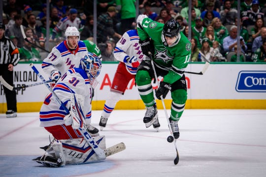 Mar 10, 2020; Dallas, Texas, USA; Dallas Stars center Andrew Cogliano (11) jumps and tries to redirect the puck pas New York Rangers goaltender Igor Shesterkin (31) during the second period at the American Airlines Center.
