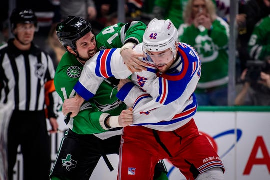 Mar 10, 2020; Dallas, Texas, USA; Dallas Stars left wing Jamie Benn (14) fights New York Rangers defenseman Brendan Smith (42) during the second period at the American Airlines Center.