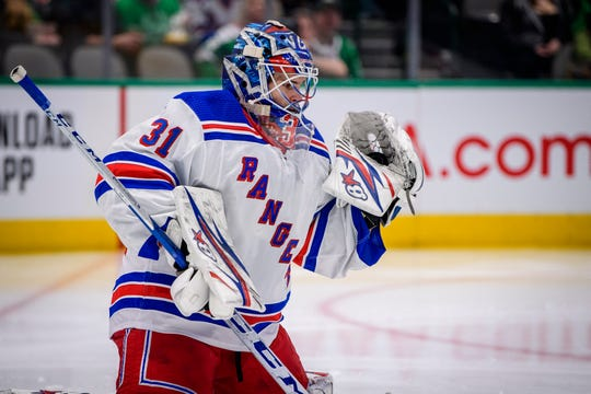 Mar 10, 2020; Dallas, Texas, USA; New York Rangers goaltender Igor Shesterkin (31) makes a save on a Dallas Stars shot during the second period at the American Airlines Center.