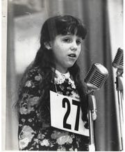 Lisa Weinstock competes in one of the many spelling bees that led her to the 48th annual National Spelling Bee in 1975.