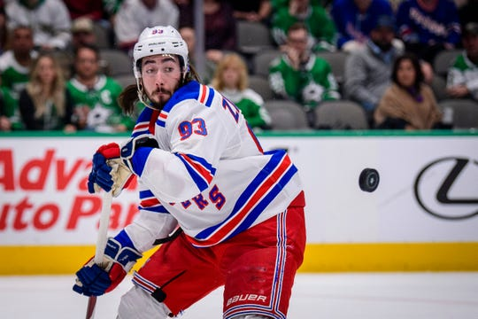 Mar 10, 2020; Dallas, Texas, USA; New York Rangers center Mika Zibanejad (93) tracks the puck in midair during the first period against the Dallas Stars at the American Airlines Center.