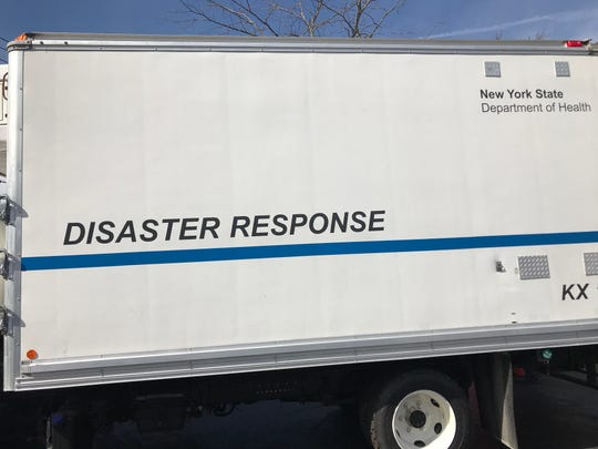 """A truck marked """"Disaster Response"""" and """"New York State Department of Health"""" parked off Route 202 in Pomona at a film set."""