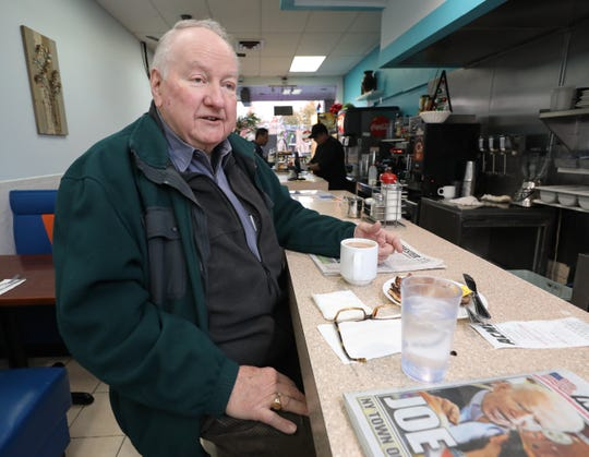 Longtime customer Frank Bergin, 82, has his breakfast in the Rochelle Diner and Coffee Shop in the Quaker Ridge Shopping Center in New Rochelle, March 11, 2020.