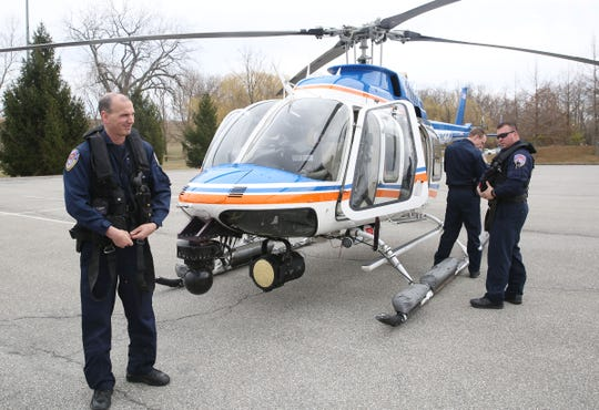 From left, Westchester County Police Aviation Unit members Richard Pucillo, Sean Lonergan and Israel Lopez get ready to head back in the air after rescuing a man from the mud near the Hudson River in Croton Point Park in Croton-on-Hudson, March 11, 2020.