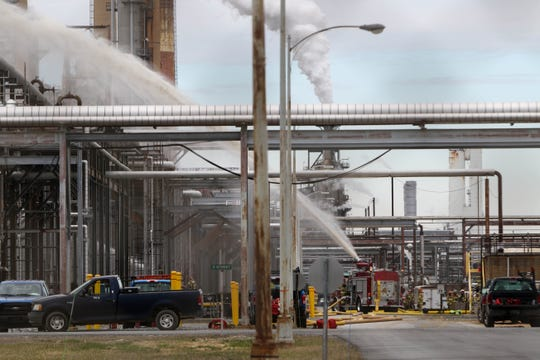 A fire truck sprays water onto the Delaware City Refinery, where a fire was reported at the around 1:30 p.m.