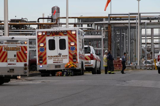 Multiple ambulances and fire trucks in front of the Delaware City Refinery, where a fire was reported at the around 1:30 p.m.