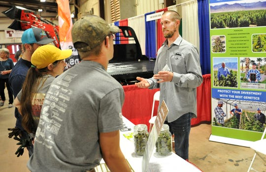 Pine Valley Farms, associate, Chris Ross talked with potential customers at their hemp seed booth during the annual Ranch and Farm show held at the J.S Bridwell Ag Center, Wednesday afternoon.