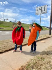 Riley ,left, and Emmalynn Mclemore dress as veggies to bring attention to Food Fight 2020 put on by the Junior League of Wichita Falls