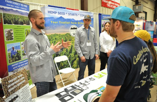 Pine Valley Farms, associate, Chris Ross, left, and company owners David and Emily Lee talk with potential customers at their hemp seed booth during the annual Ranch and Farm show held at the J.S Bridwell Ag Center, Wednesday afternoon.