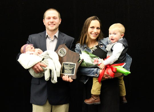 Earning the Young Distinguished Breeder award is Trent and Kelsey Hendrickson of Blanchardville who are joined by their children Grace and Trevor.