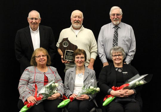 Earning the Distinguished Holstein Breeder Award was Emerald Acres of DePere. Front row from left, Joyce, Debbie and Lana Ossman. Back row from left, Don, Paul and Theo Ossman. Missing from photo was Dr. Scott Armbrust and Nancy Armbrust.