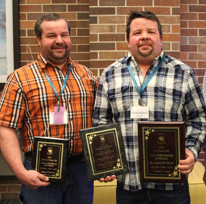 Breeders receiving honors for their Top Performer cows of 2019 were from left, Rueben Schloneger of Legacy Farms, Shell Lake, and Chris Kestell of Ever-Green-View farms of Waldo. Also winning the award was Wargo Acres of Lodi.