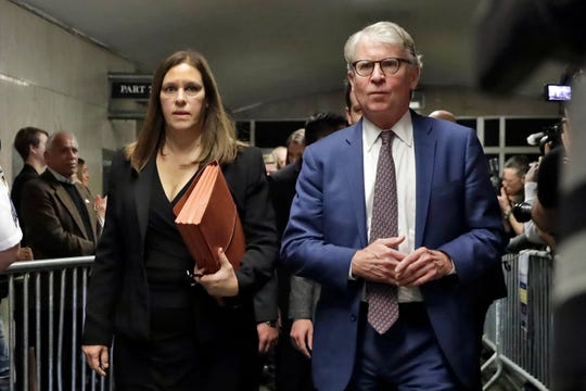 Manhattan District Attorney Cyrus Vance Jr., and Assistant District Attorney Joan Illuzzi leave court in New York after Harvey Weinstein was sentenced on March 11, 2020.