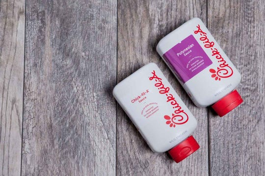 Bottles of Chick-fil-A's Polynesian sauce and signature Chick-fil-A sauce.