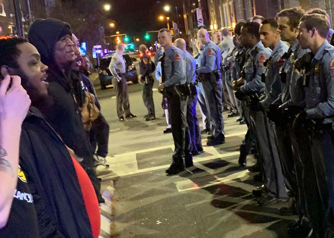 Demonstrators come face to face with police at an intersection during a protest Wednesday, March 11, 2020, in Raleigh, North Carolina.