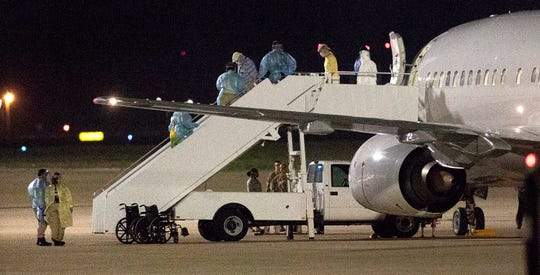 A charter plane delivered 98 healthy passengers to Lackland Air Force Base Tuesday night.