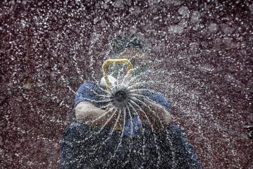 A disinfectant worker sprays anti-septic solution against COVID-19 aboard a firetruck along a street on March 11, 2020 in Manila, Philippines. Philippine President Rodrigo Duterte on Monday declared a state of public health emergency as the number of people infected with COVID-19 in the country rose to 33 from just 3 cases last week. With over 115,000 confirmed cases around the world, the coronavirus has so far claimed over 4,000 lives.