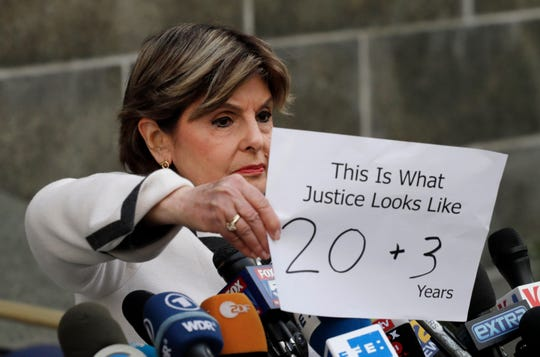 Attorney Gloria Allred holds a sign up to reporters outside the courthouse after Harvey Weinstein's sentencing on March 11, 2020, in New York.