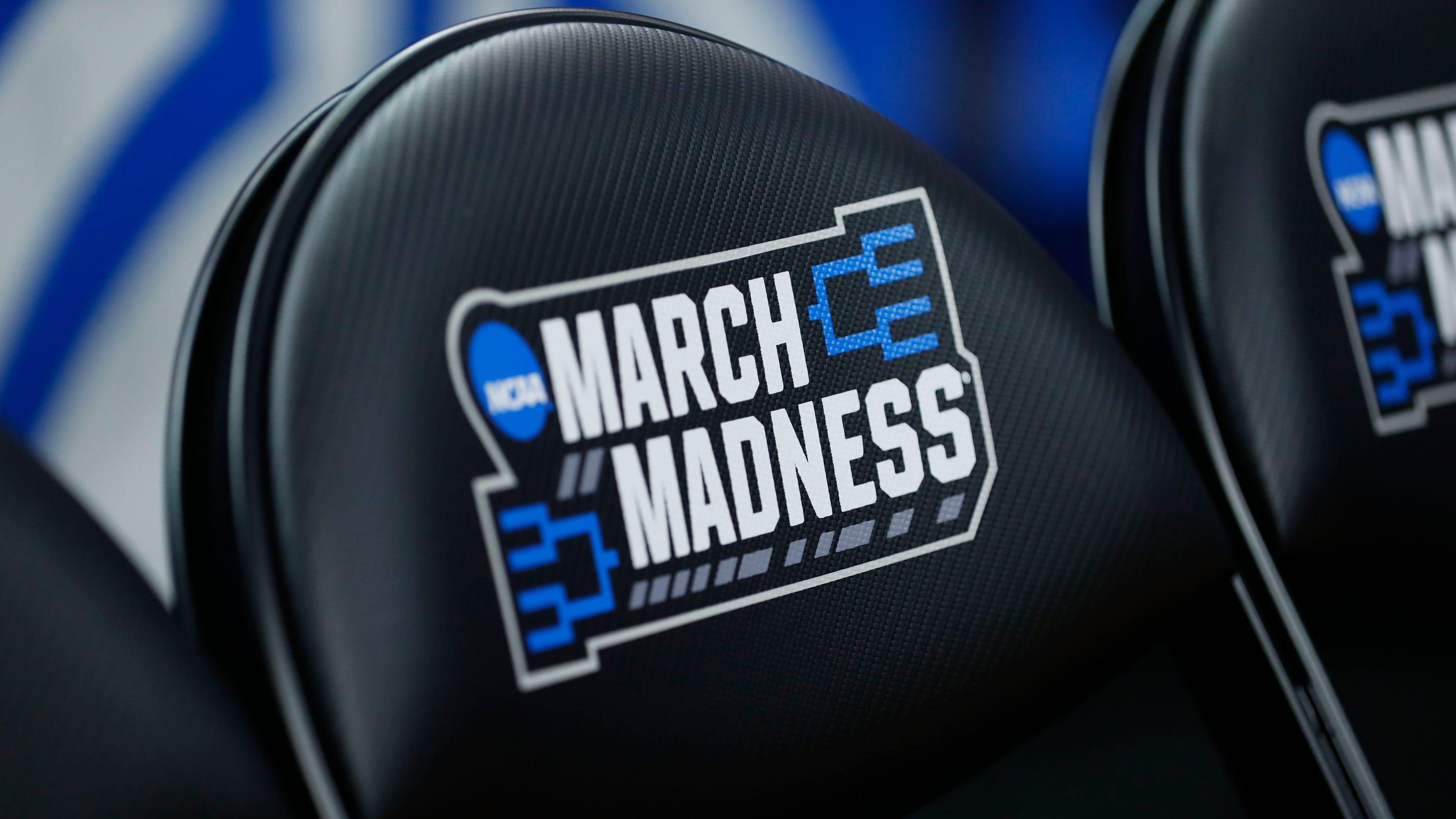 Coronavirus updates: College basketball tournaments under the microscope