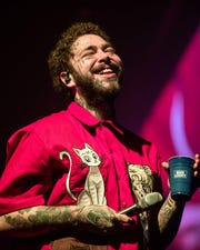 Post Malone performs onstage during his