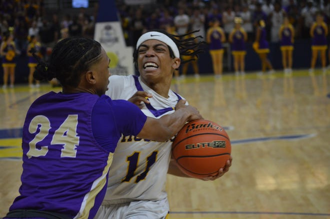 ASH senior Dez McQuain (11) is fouled by Hahnville's Corey Lorio during Wednesday's Class 5A semifinals.
