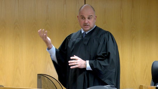 State Superior Court Judge Guy P. Ryan advises jurors of the preparations the Judiciary has made to combat the Coronavirius in the courts.  The murder trial for Anthony Barksdale had just gotten underway in Toms River Wednesday, March 11, 2020