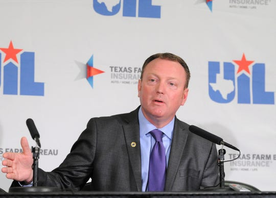 UIL Deputy Executive Director Jamey Harrison addresses media members during a conference Thursday at the Alamodome.