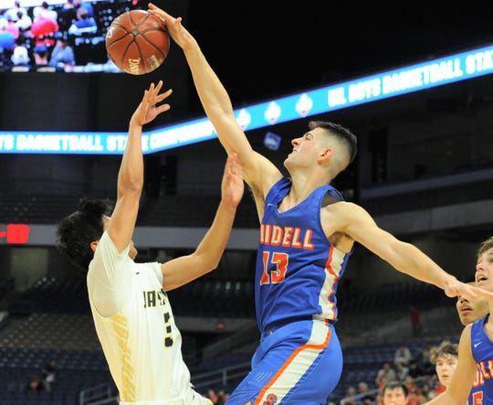 Slidell post Slayton Pruett (13) blocks a shot attempt by Jayton's Aaron Hernandez in a Class 1A state semifinal Thursday at the Alamodome in San Antonio.