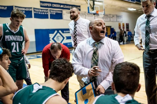 Pennfield head coach Nate Burns calls a timeout during the district semifinal on Wednesday, March 11, 2020 at Harper Creek High School. After going into a double overtime, Pennfield defeated Harper Creek 53-51.