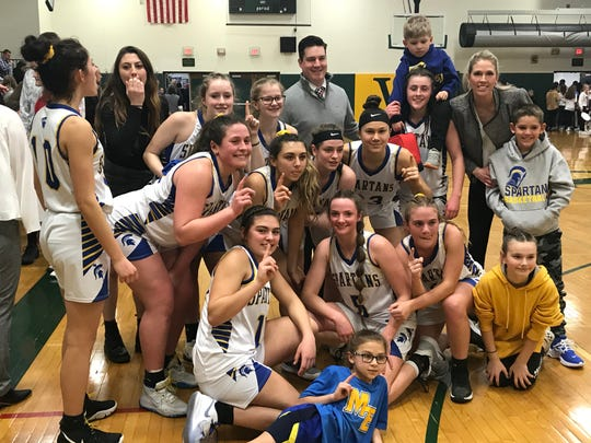 Maine-Endwell's girls are all smiles after their 49-42 Class A state playoff victory over Cornwall on Wednesday at Vestal High.