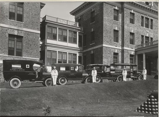 Ambulances lined up at the Puget Sound Naval Shipyard in 1918.