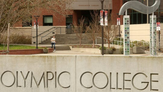 A student hurries through the empty courtyard at Olympic College in Bremerton on Thursday, March 12, 2020.