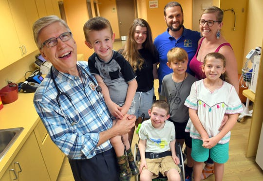 Dr. William Knappenberger of Pediatrics in Brevard, seen here with the Armistead family, all who have all been patients of his. He is holding Brodie, 4; also pictured are parents Scott and Melanie, Baylee, 16, Beau, 11, Brooklyn, 9, and seated, Brandt, 7.