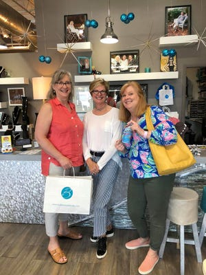 We supported local business during my sister's recent spring break visit. Bobbi's at Parkside had a nice selection, plus a can of Lysol on the counter. From left, Pat Anderson, Bobbi Whitmore, Suzy Fleming Leonard.