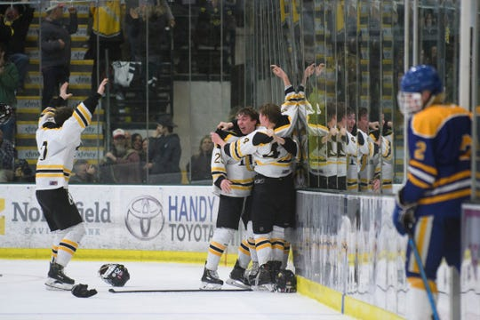 Harwood celebrates the championship during the DII boys hockey championship game between the Milton Yellowjackets and the Harwood Union Highlanders at Gutterson Field House on Wednesday night March 11, 2020 in Burlington, Vermont.