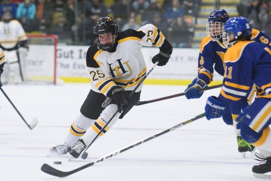 Harwood's Finn O'Hara (25) skates with the puck during the DII boys hockey championship game between the Milton Yellowjackets and the Harwood Union Highlanders at Gutterson Field House on Wednesday night March 11, 2020 in Burlington, Vermont.