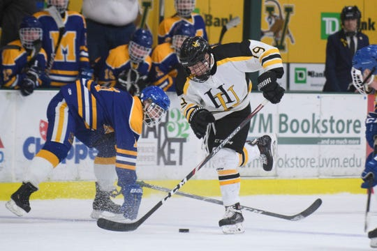 Harwood's Skylar Platt (19) skates with the puck during the DII boys hockey championship game between the Milton Yellowjackets and the Harwood Union Highlanders at Gutterson Field House on Wednesday night March 11, 2020 in Burlington, Vermont.